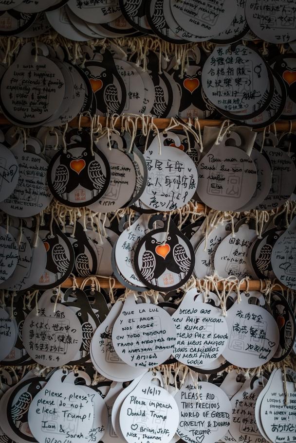 Modern prayers into the 1,300 year old Kasuga-taisha shrine.