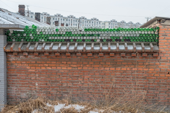 No bricks left? Glass bottles will do it!