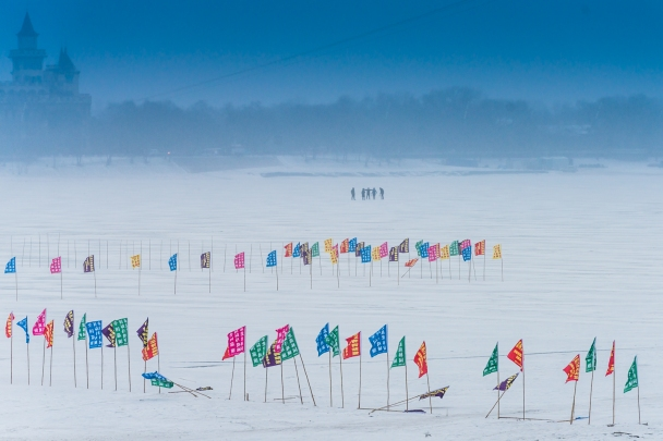 Sticks and flags on the frozen Songhua River