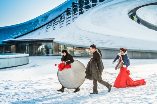 A bride from Inner Mongolia in front of Harbin Opera House